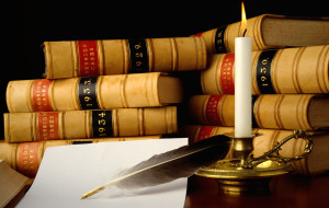 Law Book with Candel and Feather
